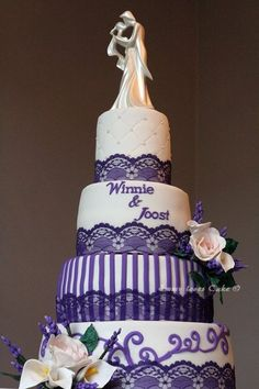purple and white with lavendel and roses  Cake by emmylovescake-- I wouldn't have it  in Purple.