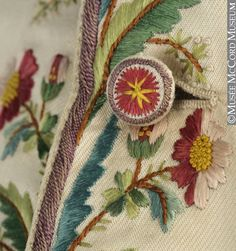 Waistcoat button detail, 1790-1799. Cream silk twill coat embroidered with floral sprays and floral motifs in multicoloured silks. McCord Museum. Beautiful!