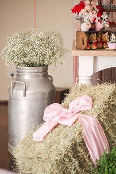 Giant milk jug filled with Babies Breath + Hay Bail from a Girly Little Farm Birthday Party via Kara's Party Ideas | KarasPartyIdeas.com (10)