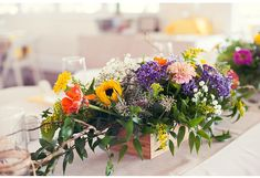 Colorful purple, yellow, orange, and pink wildflowers and ivy wedding centerpiece in rustic wooden box #mwri #wedding #centerpieces