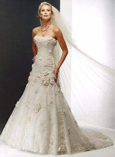 This romantic wedding gown by Maggie Sottero bridal creates a slim A-line silhouette with elaborate floral motifs and exquisite tulle lace overlay. Order complementary bridesmaid dresses and more today. Maggie Sottero Wedding Dresses, Wedding Dress Sizes, Used Wedding Dresses, Gorgeous Wedding Dress, Tulle Wedding, Bridal Dresses, Wedding Gowns, Bridesmaid Dresses, Organza Bridal