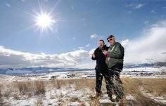 Scott Sproull and Norm Jacobson compare compass readings on a knoll north of Interstate 90. The two history buffs are attempting to pinpoint the spot where explorer David Thompson observed and sketched the Missoula Valley 200 years ago to the day. MICHAELGALLACHER/Missoulian