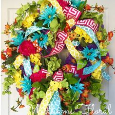 Whimsical Bright Summer and Spring Mesh Wreath by WilliamsFloral on Etsy https://www.etsy.com/listing/227279930/whimsical-bright-summer-and-spring-mesh