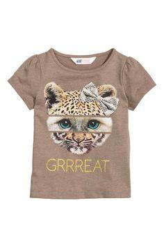 T-shirt met pofmouwen: Een zacht T-shirt van katoenen tricot met een print op de voorkant en korte pofmouwen.