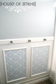 picture frame molding filled with vinyl sticker of your choice. add towel bar above with crystal knobs... gorgeous bathroom?