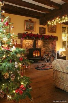 A Cosy Christmas in the Cottage looks like the fireplace we have for our wood stove.love the stove placed in the fireplace Cosy Christmas, Decoration Christmas, Cottage Christmas, Christmas Fireplace, Country Christmas, Beautiful Christmas, Christmas Home, Holiday Decor, Merry Christmas