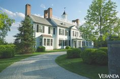 CURB APPEAL – in a colonial revival-style greenwich, connecticut, house designed by architect oscar shamamian, the shutters and door are painted in studio green, farrow & ball exterior eggshell. interior design by victoria hagan.