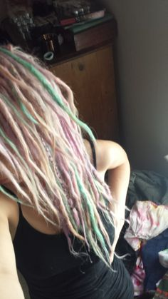 My pastel hair dreadlocks. I used Manic Panic Cotton Candy and Directions Lilac & Turquoise. The colours on their own are really bright so I faded them down to pastel colours using conditioner and a small amout of colour in a mixing bowl. The pastel effect came out perfect!