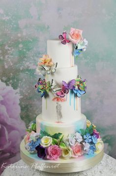 "Today was a very sunny autumn day, which unfortunately we have not so often. And today I have a very colorful wedding cake which I would like to show you. Let us call the ""love in watercolor"". All flowers and butterfly are made from flower paste."