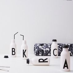 Make a cool and easy picnic table with personal water bottles. If summer hasn't arrived yet, create your own blooming meadow with our Flowers by AJ picnic blanket. Shops, Lettering Design, Design Letters, Personalized Water Bottles, Arne Jacobsen, Flip Clock, Picnic Table, Drinking Water, Picnic Blanket