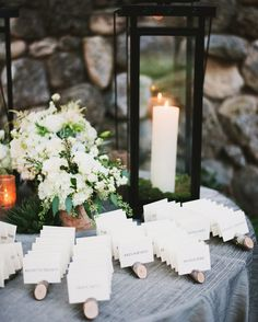 The architecture of Camp Waldemar is characterized by its historic masonry and preserved wooden beams. Playing off this rustic architectural aesthetic, Maggie sourced reclaimed tree branches to use for her escort card display.
