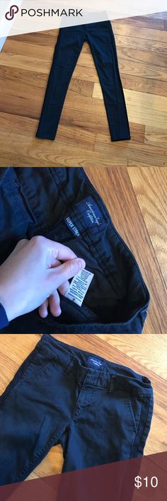 Black American Eagle Khakis Skinny Khakis Black color. With a darker black stripe down each side of legs. Used but in EUC! Size 2 (my hips measure 37inches around and I fit them.) Smoke free home all offers accepted! American Eagle Outfitters Pants Skinny