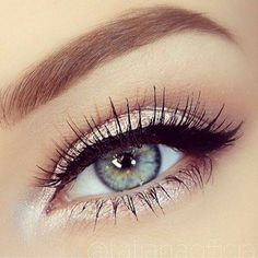 Soft brows, bright lids and under eyes, with a clean winged liner.