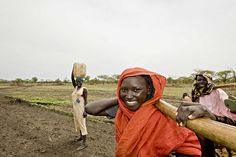 A young women walking to collect water, Jamam refugee camp by Oxfam International, via Flickr