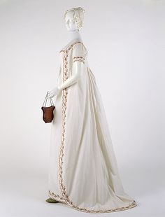 Round gown, ca. 1798  British  White cotton with polychrome wool crewel embroidered trim    Funds from various donors, 1998 (1998.222.1)