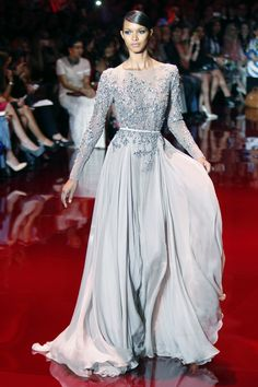 A model presents a creation by Lebanese designer Elie Saab as part of his Haute Couture Fall Winter 2013/2014 fashion show in Paris