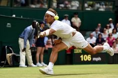 Rafael Nadal lunges for a backhand - Wimbledon 2014