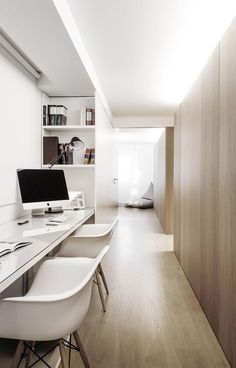 Interior Design Idea - 13 Examples Of Desks In Hallways // Soft lighting from above diffuses throughout the hallway where we find this home office. Shelves built into the sides of the office provide storage, and the desk is long enough to provide work spaces for two people.