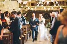 bride walks down the aisle at caswell house