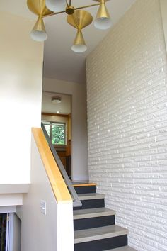 Susan & Herb's Handmade, Mid-Century Split Level. Love the paint on the stairs