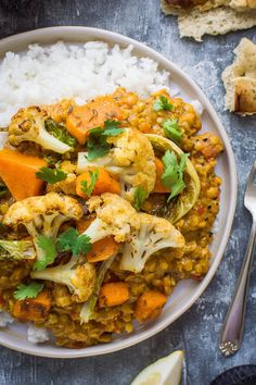 A close up of a plate of vegan red lentil dhal and rice with roasted cauliflower. A close up of a plate of vegan red lentil dhal and rice with roasted cauliflower and butternut squash. Roasted Cauliflower, Cauliflower Recipes, Veggie Recipes, Indian Food Recipes, Beef Recipes, Vegetarian Recipes, Red Lentil Recipes, Roasted Squash, Yummy Recipes