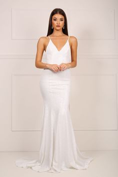 Front of white sequinned mermaid evening gown with deep v neck and crossover thin back straps and low-cut back design