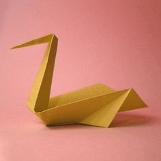This beautiful origami pelican is simple and elegant, and it will stand up by itself. Use a small sheet of square paper to create this pretty design.