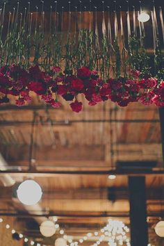 Hang red roses or carnations from the ceiling.