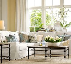 Perfect colors for living room -- yellow walls, white furniture and draperies, blue/green accessories.