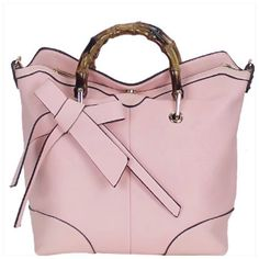 Wood Handle Satchel Pink vegan leather handbag with front bow design. Closing zipper, gold tone hardware and comes with adjustable shoulder strap. Approx size 12L x 11H x 3W. Bags Satchels
