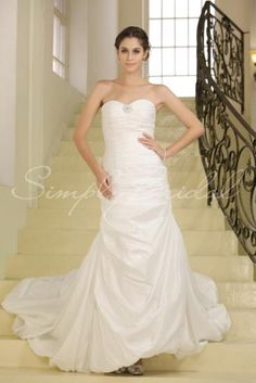 Wedding Dress by SimplyBridal. Drape yourself in elegance in this sleeveless taffeta dress. It's romantic with plenty of glamour. The gown is fitted and embodies a chapel train. The sweetheart neckline is graceful, and the A-Line silhouette was made for floating down the aisle or being. USD $549.99