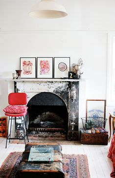 old trunk, printed rug, weathered fireplace + pops of colour.