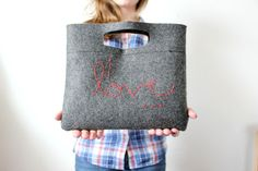 DIY Felt Purses  - If you're looking for a simple and casual clutch to carry around without breaking the bank, then these chic DIY felt purses are offering indi...