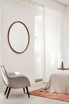 An inspiring bedroom setting. The Swoon Lounge Petit works as a perfect lounge chair for a bedroom interior. Paired together with Silhouette Mirror, Fellow Lamp and Pal Table it creates a relaxed and eased setting. #fredericiafurniture #swoonloungepetit #spacecopenhagen #fellowlamp #spacecopenhagen #paltable #keijitakeuchi #silhouettemirror #oeostudio #interiordesign #bedroominspiration #modernoriginals #craftedtedolast Space Copenhagen, Co Working, Wood Surface, Leather Furniture, Lounge Areas, Accent Chairs, Relax, Interior Design, The Originals