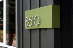 Modern house numbers and a pop of color makes them stand out.