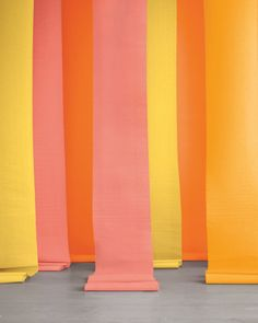 This eye-catching backdrop is one of the most effective and cost effective. It's made from unfurled rolls of crepe paper, which is insanely affordable and light enough to hang from the ceiling with painters' tape. What a fantastic idea!