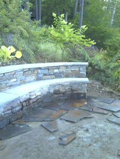 This is one of my Natural Blue Stone projects, a bench with the beginning of a flag stone patio! 2012