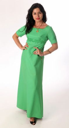 This bright green, floor-length, A-line, embroidered gown is probably from the late 1960's or 70's. It was $8 at the Salvation Army. (Allison Carey/The Plain Dealer)