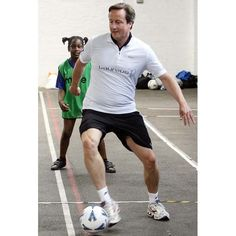 Conservative party leader David Cameron joins in with a game of football with children at the Lilian Baylis Old School, Kennington, 14 July 2009 David Cameron, Sports Photos, Old School, Sporty, Lol, Football, Running, Game, Country