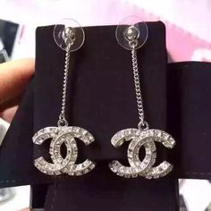 Chanel logo earrings Chanel dangle earrings. Received as a gift set with Chanel necklace in separate listing. CHANEL Jewelry Earrings