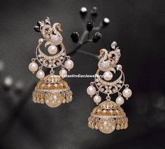 Diamond jhumka earrings in exotic peacock design bali shaped tops attached to diamond jhumkas with pearl drops looks magnificent and stylish. Silver Jewellery Indian, Indian Wedding Jewelry, Silver Bangles, Bridal Jewelry, Gold Jewellery, Silver Rings, Diamond Jhumkas, Diamond Studs, Diamond Earrings