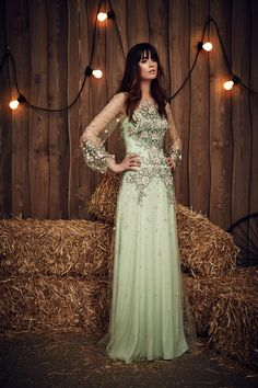 If you don't actually mind the thought of a green wedding dress (and why not!), consider the Apache in celadon from Jenny Packham, which has a spring-green colour palette and beautiful floral detail.