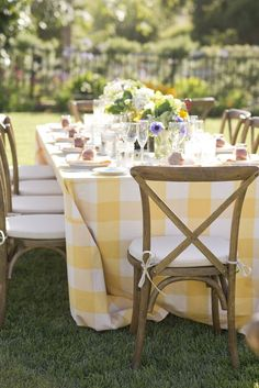 A fun tablecloth for either the bistro tables or dining tables. | yellow and white table cloth in backyard wedding reception