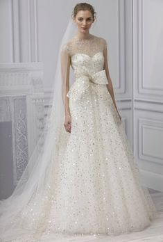 An amazing and ethereal Monique Lhuillier wedding gown.  How can you not love it?!