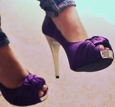 Purple shoes with the golden heel...