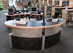 I think that this is another good option for having the circulation desk in the center.