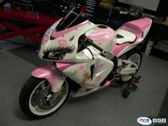 Can't tell what bike this is, maybe yamaha R something?  But I think it is brilliant.  #girly motorbike