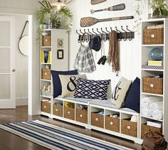 Make this PB look with Ikea Kallax shelves, cushions, and baskets. Perfect for weird unused hallway!! - Samantha Entryway Set, Set of 2 benches & 2 bookcases | Pottery Barn