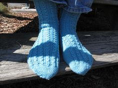 """Basic toe up, worsted weight textured socks in 2 sizes for men & women, using a """"fake cable"""" stitch. This is a great pattern for slipper socks, charity socks, or a quick gift!"""
