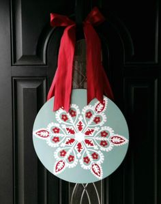 Give your front door a makeover this holiday season with one of these simple DIY door decorations that go beyond the basic wreath.